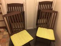 Four solid wood garden chairs with cushions