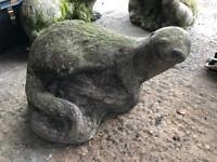 Stone otter garden ornament