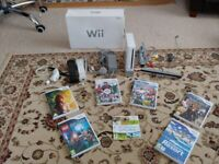 Nintendo Wii, 2 motion plus controllers, 1 nunchuck + 7 games