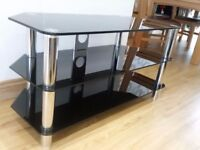 Very nice Black glass TV STAND for sale.