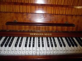upright piano by hermann mayr