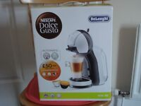 COFFEE MAKER BY DE LONGHI, MINI ME, DOLCE GUSTO. NEW, BOXED AND UNOPENED.