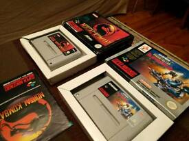 Super Nintendo games Probotector and Mortal Kombat 2 boxed with instructions
