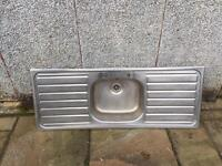 Stainless steel sink with double drain
