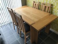 2 and 3 seater brown leather sofas + oak dining room table, chairs and large mirror