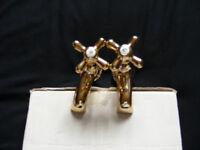 Gold / brass bath taps.