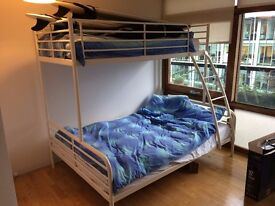 IKEA double + single bunk bed with mattresses.