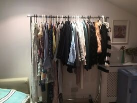 Adjustable metal clothing rack