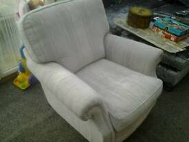 Lovely comfy quality modern armchair with brass castor feet