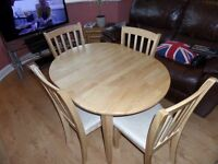 Extending Natural Wood Dining Table and 4 Chairs with cream fabric padded seating