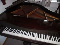 small baby grand piano by challen