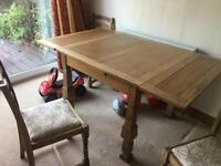 Extending oak dining table and 4 ladder back oak chairs