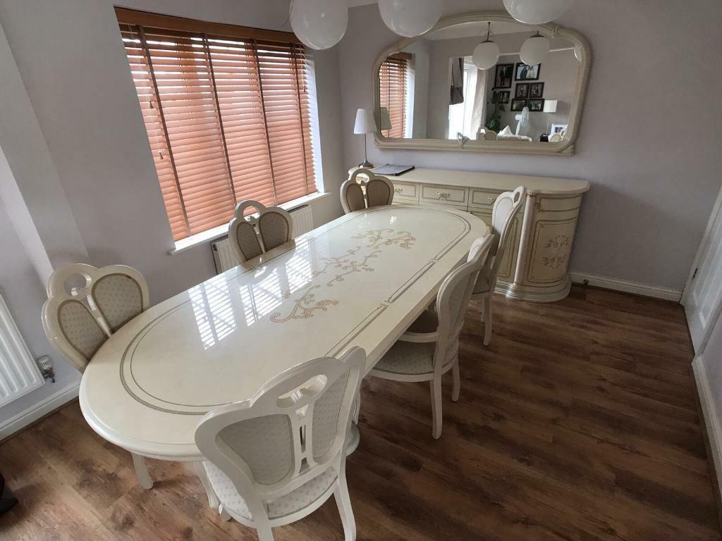 Dining table and chairs with matching sideboard and mirror