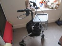 Excellent condition three wheeled movalator with basket, bag and two wheeled braking