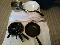 POTS AND PANS 5INCH-11INCH./STAINLESS STEEL POT WITH LID 8PLUS INCH/CERAMIC 11INCH PAN.