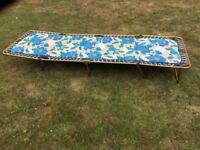 Four folding camp beds