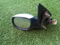 Silver Peugeot 206 electric wing mirror