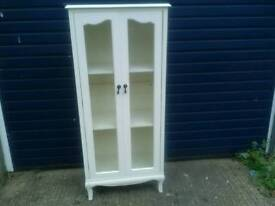 Cream , glass display cabinet in good condition