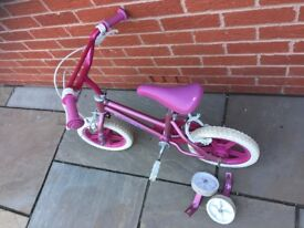 Girls pink bicycle; easy to ride