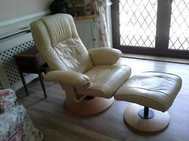 cream leather swivel recliner.100cm upright. stool 50cm high. 50cm sq with slope.
