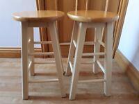 Solid wood cream bar stools.