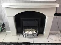 Black and white fireplace with electric fire