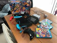 Wii u with games and box