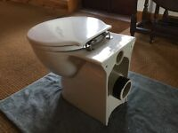 Ideal standard round back to the wall toilet pan and seat. White. Variable seat position.