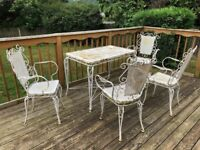 Antique Patio Furniture- Large table and four chairs. Cast iron hanging stand.