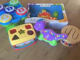 An assortment of baby/toddler toys