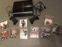 PlayStation 3 with two controllers and 8 games