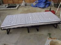 Two Fold up Iron Beds like new