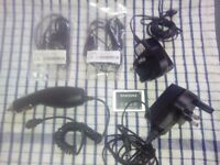 Samsung. Nokia and Alcatel phone chargers 2 Samsung head phones and a Samsung battery,