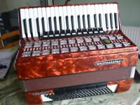 beautiful red full size 120 key bass quality weltmeister accordian,in perfect condition,excellent...