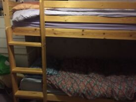 Bunk bed with two single mattresses