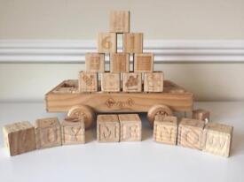 Children's carved wood building block set