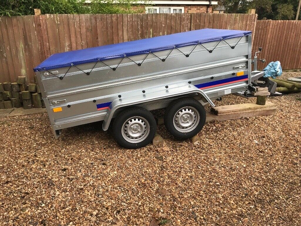 Trailer brand new with mesh sides and cover