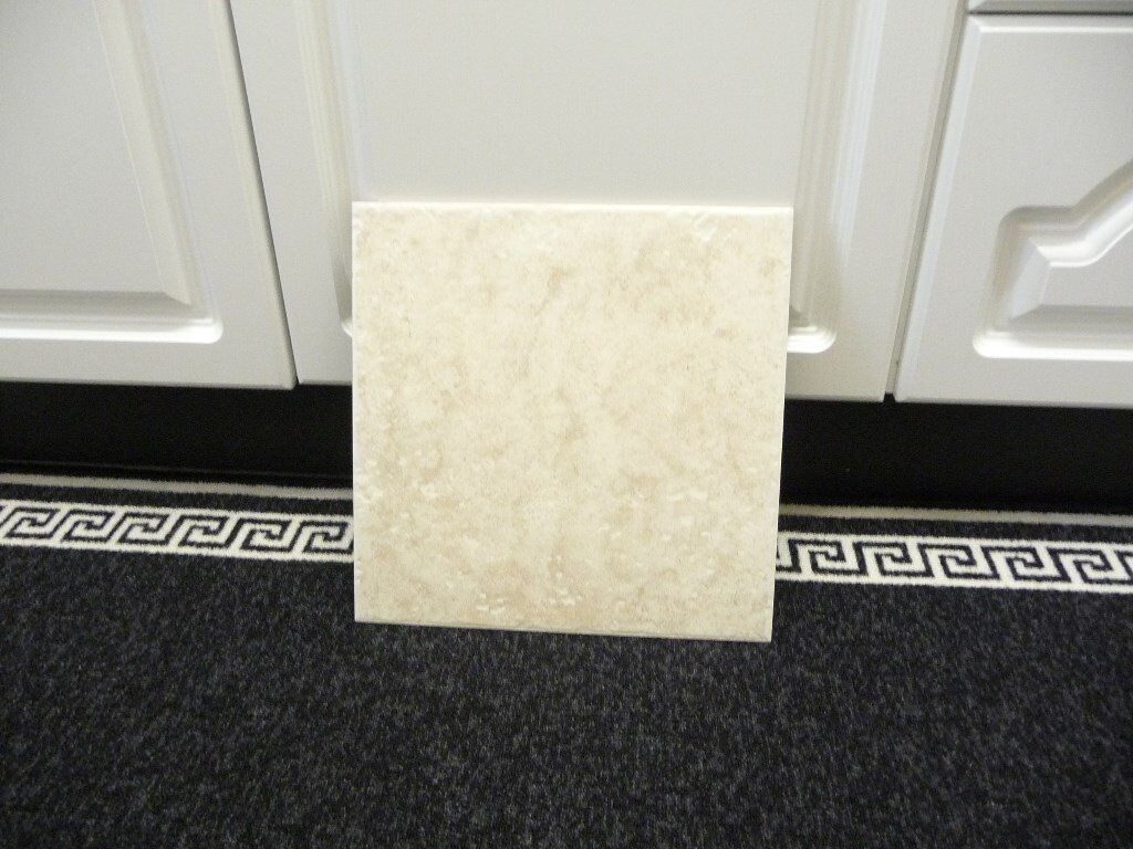 For sale 9 Boxes of mottled cream ceramic tiles 13in x 13in