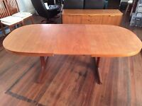 Danish teak dining table with insertable leaf extension