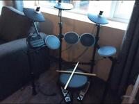 Electric drum kit, speaker and stool