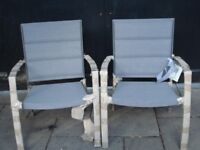 NEW A PAIR OF OUTSIDE GARDEN CHAIRS STILL IN WRAPPERS