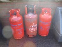 THREE GAS PROPANE GAS BOTTLES ONE FULL ONE HALFE FULL AND ONE EMPTY