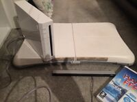 Wii console, controllers, wii board, games for sale good condition
