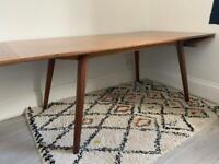 Habitat walnut wing dining table designed by Simon Pengelly