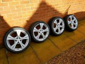 4 refurbished Alloys with band New tyres
