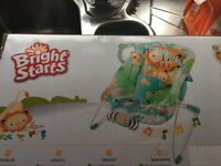 Brand new in box Bright Starts Playful Pals baby bouncer