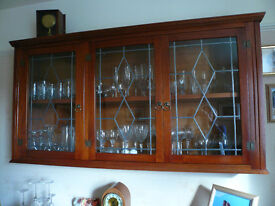 Timber wall cabinet, with leaded glass doors. Exc. condition £25.00
