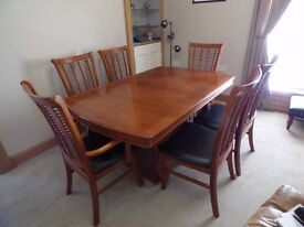 Extending rosewood dining table and 6 chairs