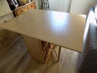 Foldaway table and 4 chairs