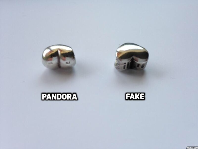 This photo shows the Pandora hallmarks on top of the heart (925 ALE) although they have worn off slightly.